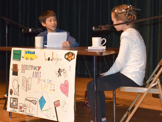 Nolan Huang portrays Milton Hershey as he answers the questions of host Laurel French at African Road Elementary School.