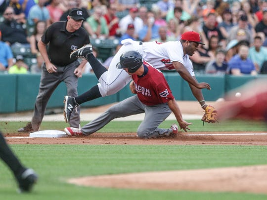 The IronPig's Cam Perkins slides safely in to third base past the Indianapolis Indians Jason Rogers, to score a run, Tuesday July 19th, 2016. Perkins was a stand out player during his time in Indiana at Southport High School and Purdue.
