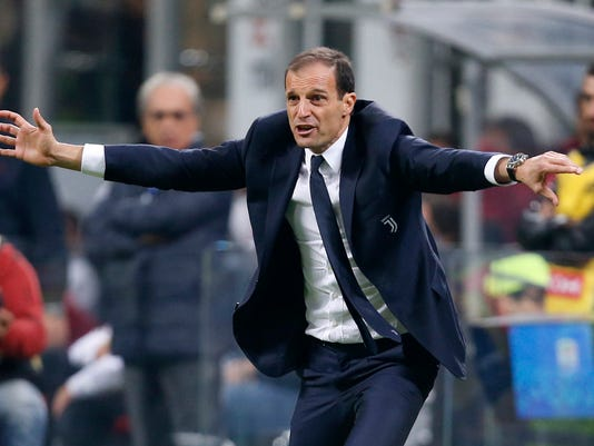 FILE - In this Saturday, Oct. 28, 2017 file photo, Juventus coach Massimiliano Allegri gestures to his players from the sidelines during a Serie A soccer match between AC Milan and Juventus, at the Milan San Siro stadium, Italy, Saturday, Oct. 28, 2017. Juventus coach Massimiliano Allegri has won the golden bench coaching award voted by his colleagues for last season. In 2016-17, Allegri guided Juventus to a record sixth straight Serie A title, a third straight Italian Cup championship and the Champions League final. Allegri received 19 votes, Gian Piero Gasperini of Atalanta finished second with 11 votes and Maurizio Sarri of Napoli came third with seven. It's the third time Allegri has won the award. (AP Photo/Antonio Calanni, File )