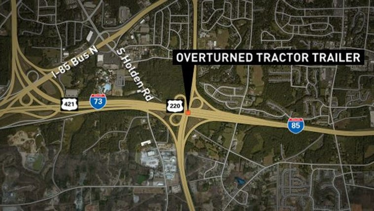 Overturned tractor-trailer closes ramp from I-73 onto