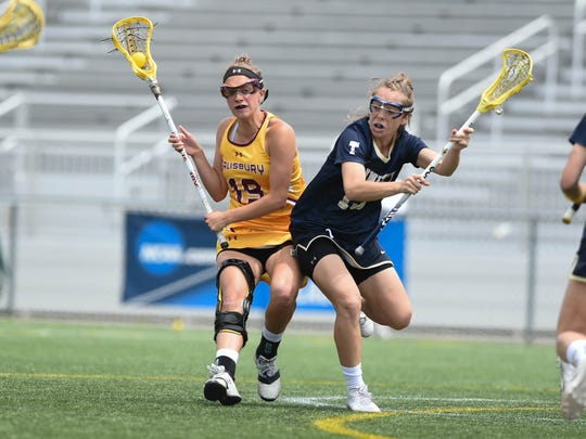 Salisbury University's Allie Hynson battles against Trinity (Conn.) College on Sunday, May 20, 2018, during the NCAA Division III lacrosse quarterfinals at Seagull Stadium.