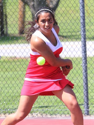 CVU's No. 1 singles player Kathy Joseph keeps her eye on the prize during the Redhawks' 5-2 win over South Burlington in the Division I finals Thursday.