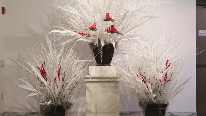 Festive holiday floral arrangements are on display at a number of gardening exhibitions throughout the holidays..