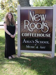 Aria Matthews, owner of New Roots Coffeehouse, 1273 Long Pond Road in Greece.