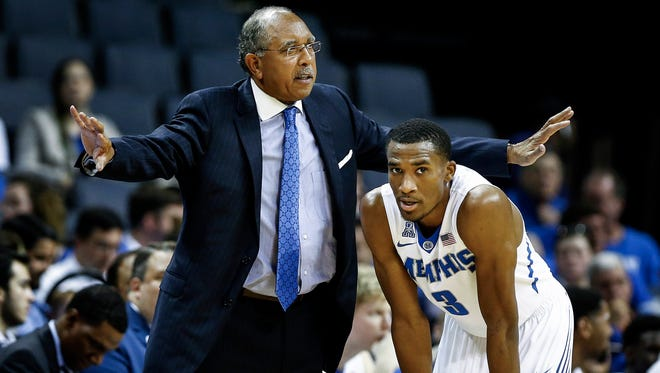 University of Memphis head coach Tubby Smith (left) chats with guard Jeremiah Martin (right) during first half action against University of Texas Rio Grande Valley at FedExForum.