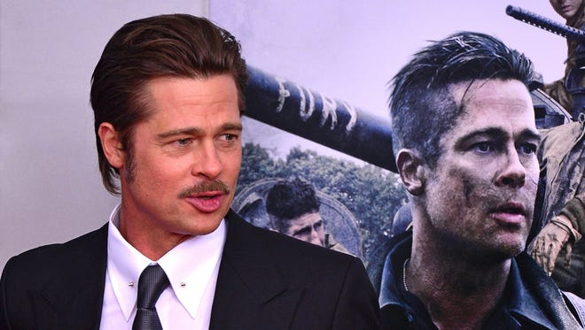 "Brad Pitt attends the ""Fury"" premiere in  Washington."