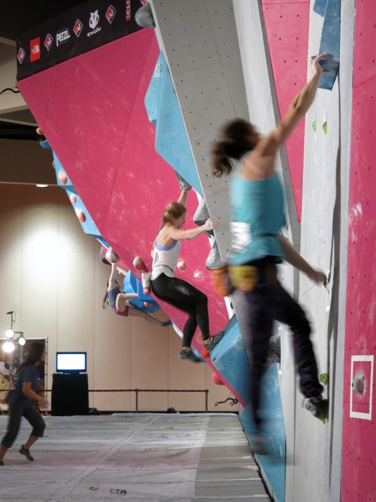 In this Jan. 29, 2016 photo, contestants compete in the Bouldering Open National Championships at Monona Terrace in Madison, Wis. Bouldering is a discipline in the sport of climbing. Climbing is on the precipice of becoming an Olympic sport, raising the profile of what might have been more commonly considered a recreational activity for weekend warriors. The International Olympic Committee will decide in August in Rio whether to add climbing to the 2020 Tokyo Olympics. (AP Photo/Genaro C. Armas)