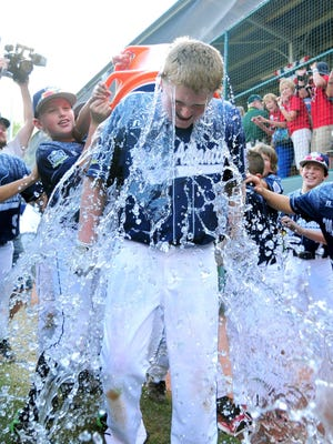 Chayton Krauss gets doused after driving in the game-winning run for Pennsylvania.