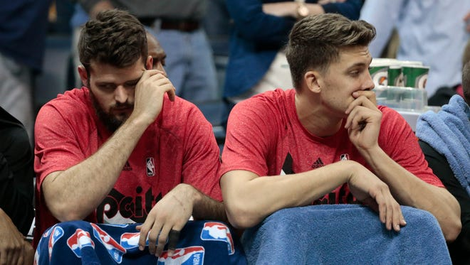 Portland Trail Blazers centers Joel Freeland, of England, left, and Meyers Leonard, right, sit on the bench in the final moments of the second half of Game 2 of an NBA basketball Western Conference playoff series against the Memphis Grizzlies Wednesday, April 22, 2015, in Memphis, Tenn. The Grizzlies won 97-82 and lead the series 2-0.