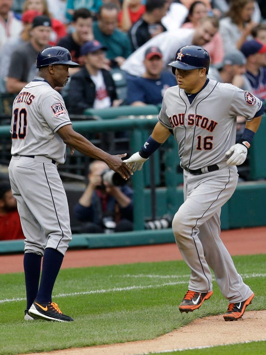 Houston Astros' Hank Conger (16) is congratulated by third base coach Gary Pettis after Conger hit a solo home run off Cleveland Indians starting pitcher Cody Anderson in the third inning of a baseball game, Thursday, July 9, 2015, in Cleveland. (AP Photo/Tony Dejak)