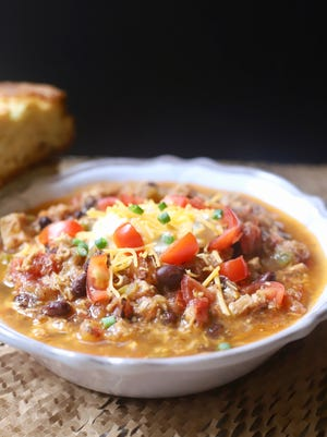 Hearty Chicken Chili with a Twist in a white bowl, ready to serve