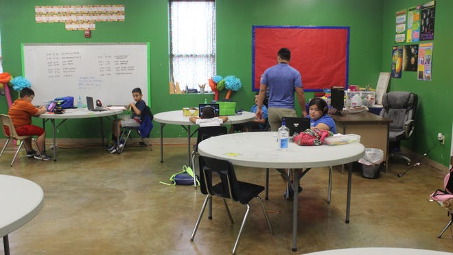 Students at the Boys and Girls Club taking advantage of the academic program to support distance learning in the community.