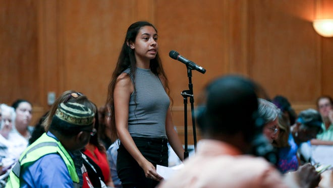 Destine Grigsby, representing the Kentucky Student Environmental Coalition, spoke against a Rubbertown chemical plant's request for relaxed pollution risk goals under the city's 2005 Strategic Toxic Air Reduction program.
