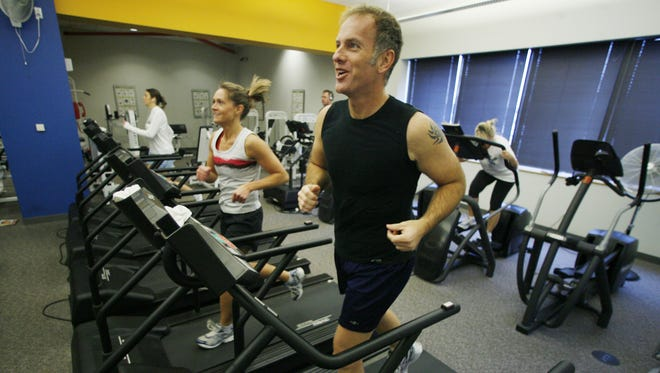 In this Jan. 4, 2008 file photo, Mark Weaver, 45, incorporates cardio in his workout. Iowa State sports psychologist Marty Martinez said you should commit to at least 10 minutes of physical activity every day.