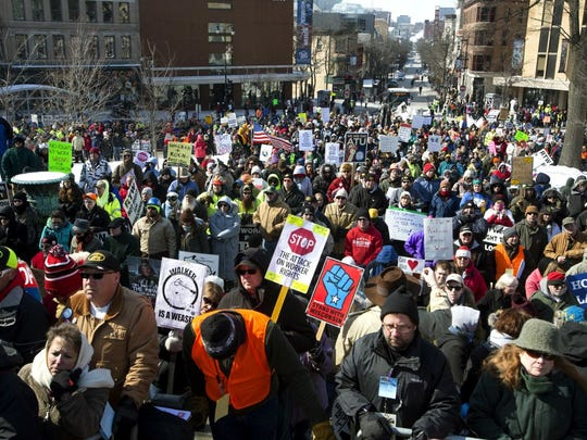 "Participants march in a rally against a ""right-to-work"" proposal, on Saturday, Feb. 28, 2015, in Madison, Wis. Thousands of Wisconsin union workers rallied at the Capitol Saturday to protest a ""right-to-work"" proposal that would outlaw the mandatory payment of union dues, but the crowd was much smaller than those in 2011 against Gov. Scott Walker's law stripping public sector unions of much of their power."