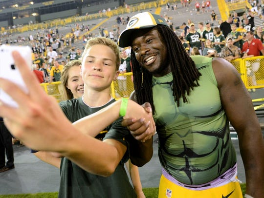 Noah Steward, 14, takes a 'seflie' with running back