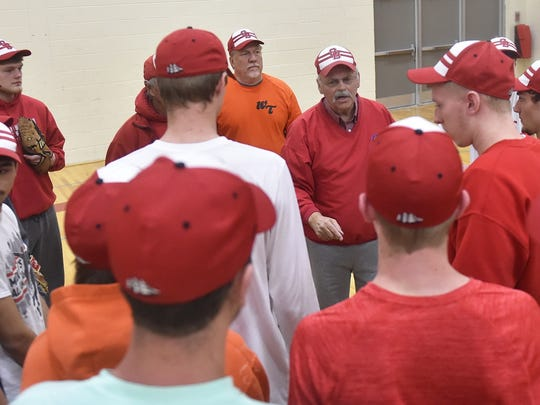 First-year Sturgeon Bay baseball coach John Berns, center, inherits a team that returns several seniors from last year's squad.