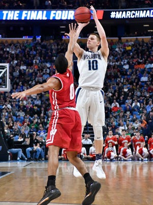 Mar 18, 2017; Buffalo, NY, USA; Villanova Wildcats guard Donte DiVincenzo (10) shoots over Wisconsin Badgers guard D'Mitrik Trice (0) in the second half during the second round of the 2017 NCAA Tournament at KeyBank Center. Wisconsin won 65-62. Mandatory Credit: Mark Konezny-USA TODAY Sports