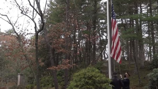 Old Glory is raised during a Veterans Day ceremony at Sleepy Hollow Cemetery in Concord on Wednesday, Nov. 11.