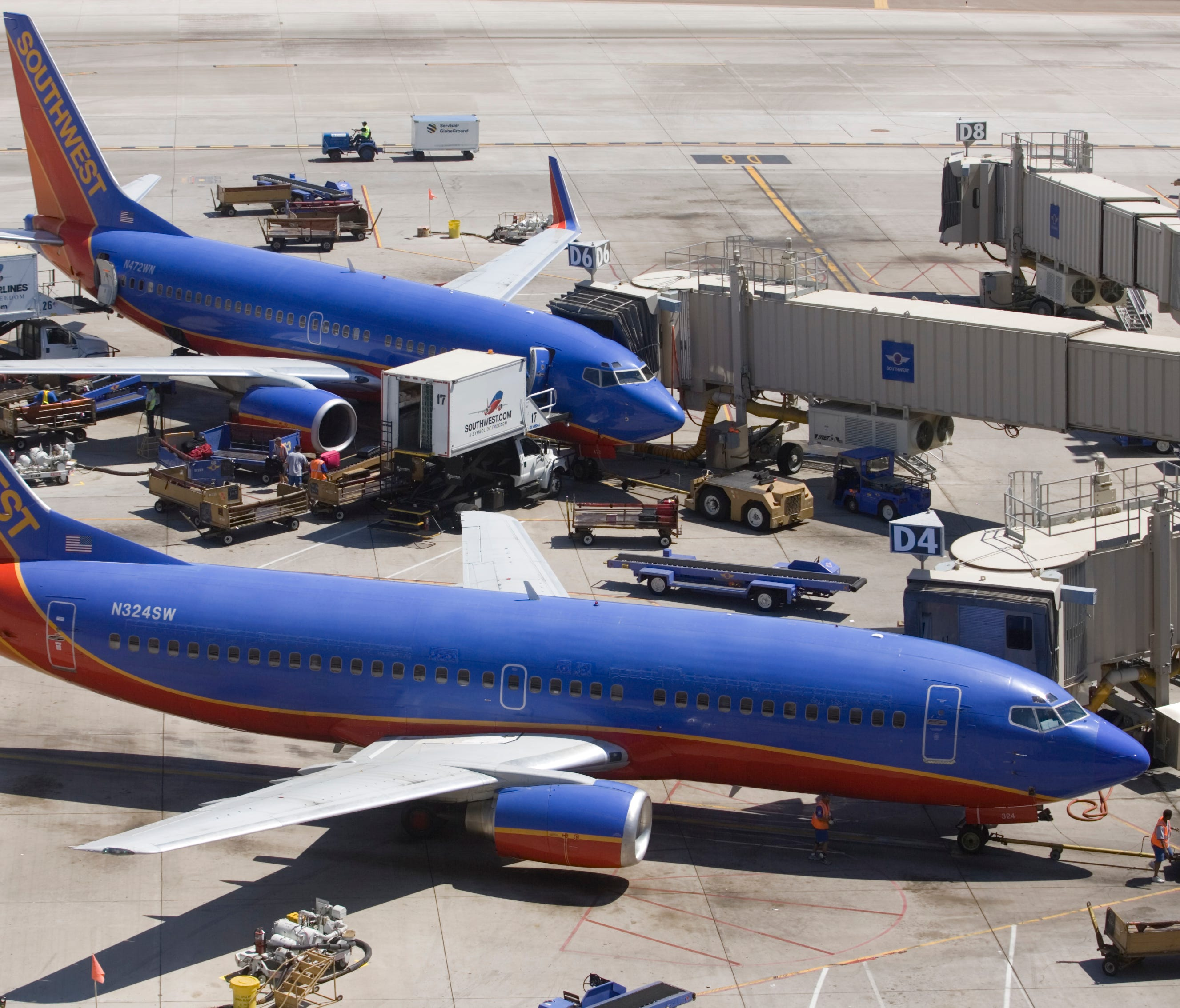 Southwest Airline planes are seen on the runway at Sky Harbor Airport in Phoenix on Tuesday, July 17, 2007.