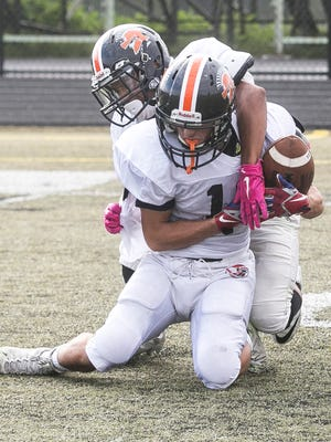 York Suburban Ben Salazar (10) gets tangled with teammate Savion Harrison (7) after making a catch during practice earlier this season. The Trojans have won six straight games and finally moved into a playoff spot in the District 3 4-A power ratings. Amanda J. Cain photo
