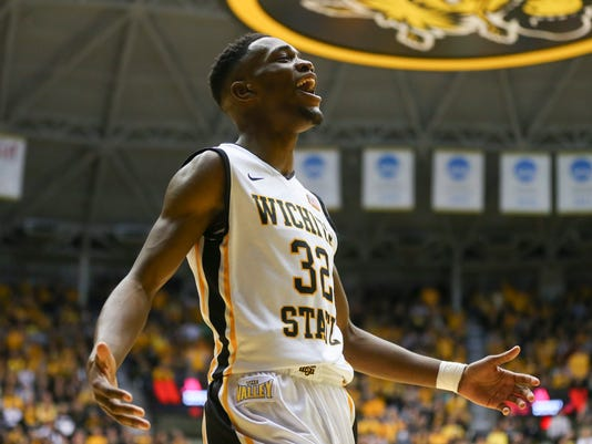 Wichita State forward Markis McDuffie celebrates after being fouled by Evansville during the first half of an NCAA college basketball game on Wednesday, Jan. 6. 2016 in Wichita, Kan. (Travis Heying/The Wichita Eagle via AP)