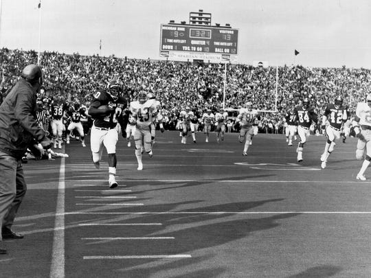 Running back Levi Jackson dashes for an 88-yard touchdown that gave MSU a 16-13 win over Ohio State in 1974.