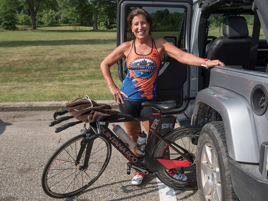 Julie Bedford rode 30 miles on a hot, humid morning, training for her next triathlon.
