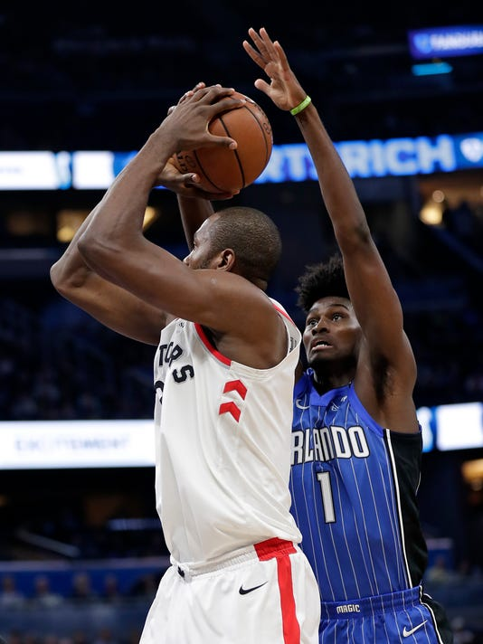 Orlando Magic's Jonathan Isaac (1) blocks a shot attempt by Toronto Raptors' Serge Ibaka during the first half of an NBA basketball game, Tuesday, March 20, 2018, in Orlando, Fla. (AP Photo/John Raoux)