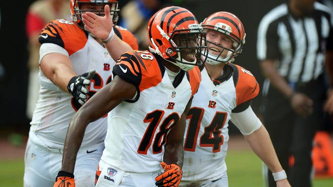 Bengals WR A.J. Green (18) and QB Andy Dalton have never missed postseason but never  won there, either.