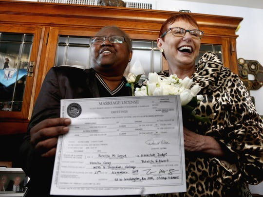 Vernita Gray, left, and Patricia Ewert hold their Illinois