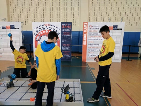 Members of the Carlstadt robotics team made sure their robots were in working order before the competition between 11 school districts on March 29.