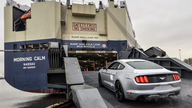 A 2015 Mustang coupe bound for Asia is loaded on a ship at the port of Portland in Oregon.