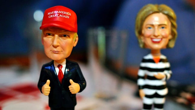 Bobble head figurines of Republican presidential nominee Donald Trump and Democratic presidential nominee Hillary Clinton. The figurines greeted Republican party supporters watching a presidential debate hosted by the Colorado Republican Party at Choppers Sports Grill in Denver, Colorado, on Oct. 9, 2016.