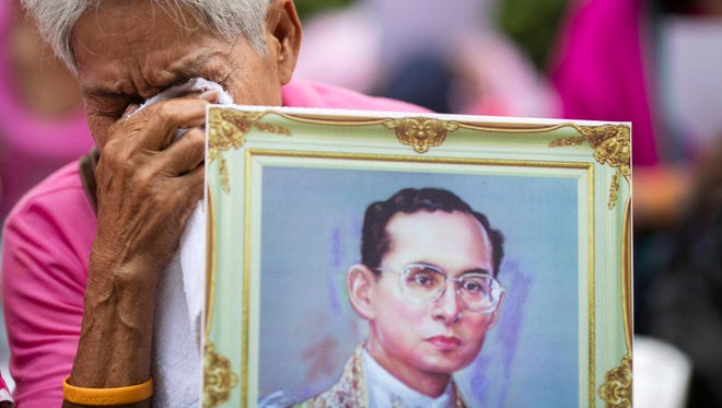 A woman prays for Thailand's King Bhumibol Adulyadej at Siriraj Hospital where the king is being treated in Bangkok, Thailand, on Oct. 13.