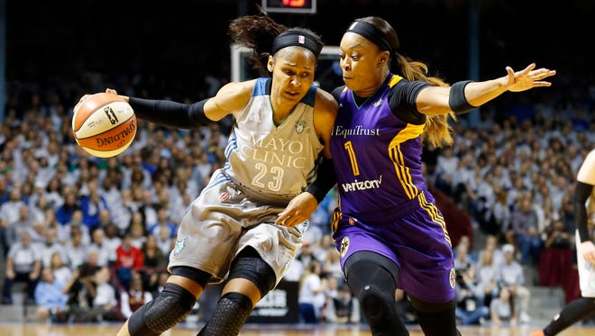 Minnesota Lynx's Maya Moore, left, drives around Los Angeles Sparks' Odyssey Sims in the first half during Game 5 of the WNBA Finals Wednesday, Oct. 4, 2017, in Minneapolis.