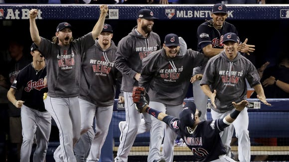 In this Wednesday, Oct. 19, 2016, file photo, Cleveland Indians first baseman Carlos Santana celebrates after making the final out in their 3-0 win over the Toronto Blue Jays in Game 5 of baseball's American League Championship Series in Toronto. Four months after LeBron James and the Cavaliers ended the city's championship drought at 52 years by winning the NBA title, the Indians are back in the World Series for the first time since 1997.