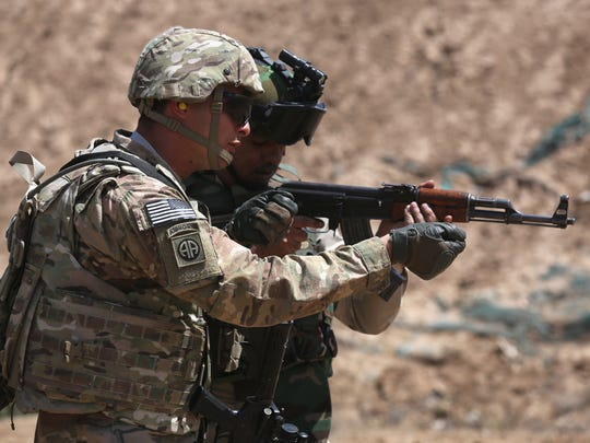 A U.S. Army trainer, left, instructs an Iraqi Army