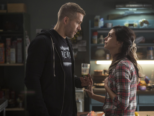 "Wade Wilson (Ryan Reyonlds) and new squeeze Vanessa (Morena Baccarin) trade some pointed barbs, in ""Deadpool."""