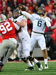 Michigan State quarterback Damion Terry  throws a long pass to Macgarrett Kings Jr. in the first half against Ohio State.