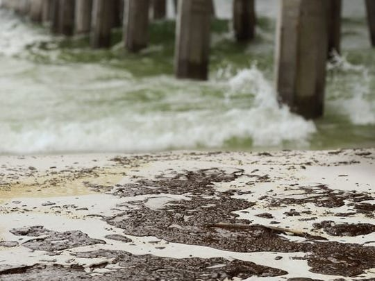 The Pensacola Beach Pier in June 2010 when the Deepwater Horizon oil spill washed ashore on the beach.