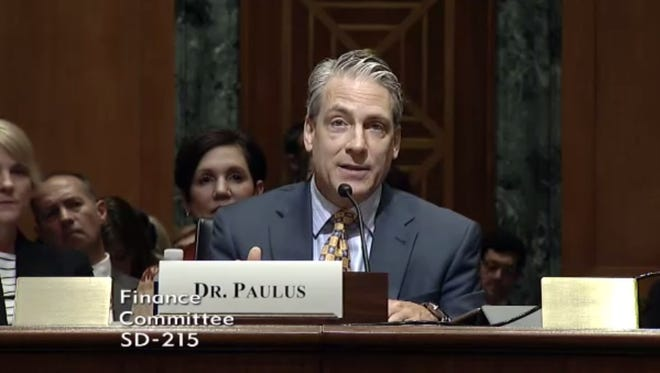 Dr. Ron Paulus, president and CEO of Mission Health, testifies before the U.S. Senate Finance Committee in Washington Tuesday.