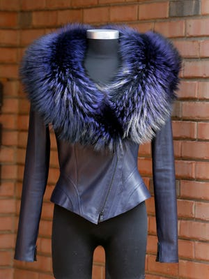 Jitrois Veste cross leather marine and fox fur collar, price upon request, at CoCoPari in Red Bank.