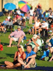 Families gather for an Independence Day Concert at the Riverwalk Amphitheater in Montgomery on July 4, 2014. The amphitheater is just one of Montgomery's many attractions.