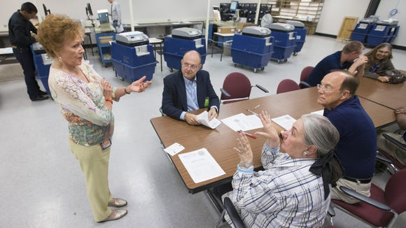 Maricopa County Recorder Helen Purcell speaks with Republican and Democratic observers during an inspection of voting machines in May.