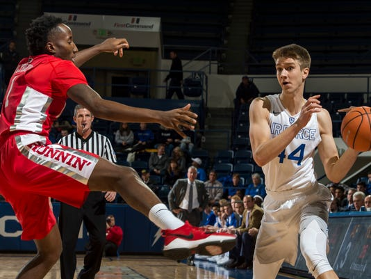 Air Force guard Keaton Van Soelen, right, looks for an open teammate as UNLV's Kris Clyburn defends during an NCAA college basketball game at Air Force Academy, Colo., Wednesday, Jan. 10, 2018. (Dougal Brownlie/The Gazette via AP)