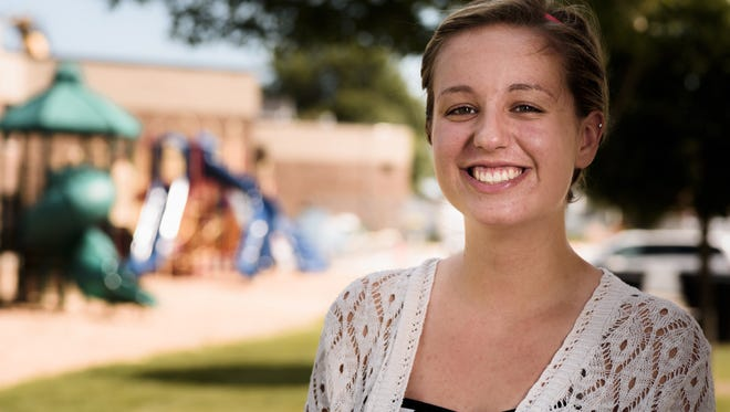 Little Chute's Hannah Dornfeld volunteers with Operation Backpack, an organization that helps children with food when they're not in school.