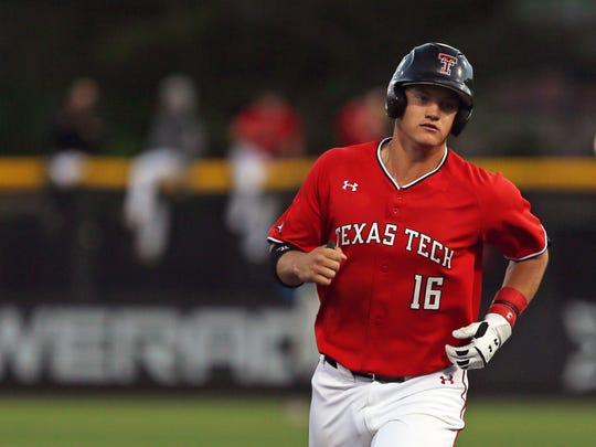 Texas Tech's Josh Jung (16) runs the bases after hitting a home run during an NCAA college baseball game against Oklahoma State in Lubbock, Texas, Saturday, April 27, 2019. Texas Tech is finding its groove just in time for the home stretch of the regular season. The Red Raiders, who had a losing record in Big 12 play less than two weeks ago, are 1 1-2 games behind first-place Baylor after a weekend sweep against an Oklahoma State team that came in leading the league.(Sam Grenadier/Lubbock Avalanche-Journal via AP)