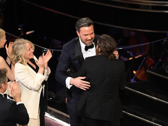 Ben Affleck hugs his brother Casey after his name is