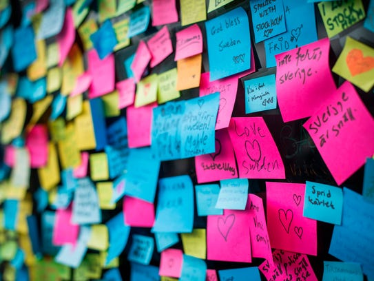 Thousands of sticky notes are pictured at a makeshift